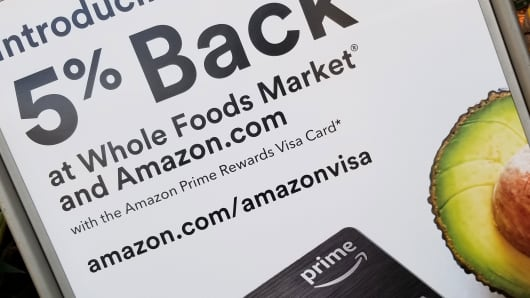 Sign at Whole Foods market grocery store in San Ramon, California announcing promotion in which Amazon Prime credit card holders receive a 5% discount when shopping at the store, February 27, 2018.