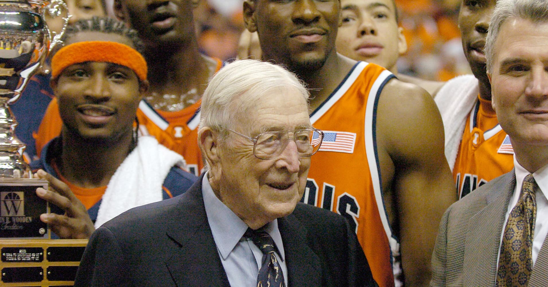 Coach John Wooden with Dee Brown, Coach Bruce Weber and other members of the winning Illinois team after Illinois 89-70 win in the John Wooden Tradition in Conseco Fieldhouse, Indianapolis on November 27, 2004.