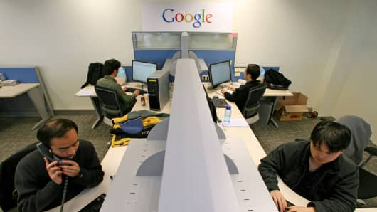 Google engineers work in the company's office.