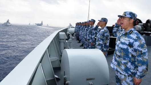 A PLA Navy fleet including the aircraft carrier Liaoning, submarines, vessels and fighter jets take part in a review in the South China Sea on April 12, 2018.