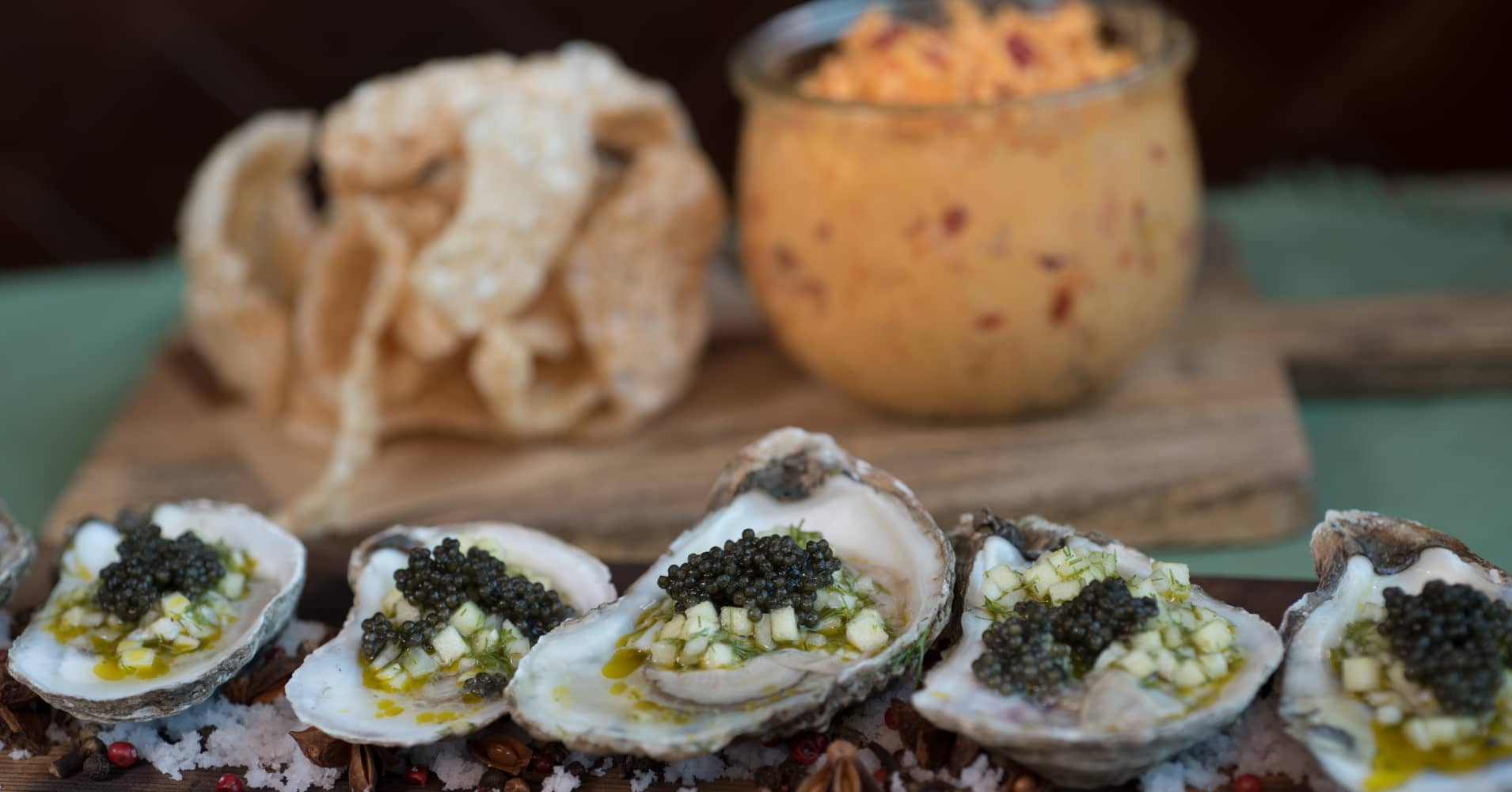 The appetizers include chilled oysters and cracklins' with pimento cheese