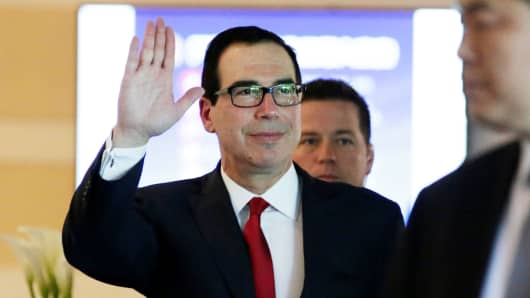 Treasury Secretary Steven Mnuchin waves to the media as he and the U.S. delegation for trade talks with China, leave a hotel in Beijing, China May 3, 2018.