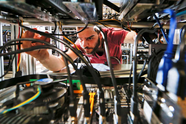 An employee works on bitcoin mining computers.