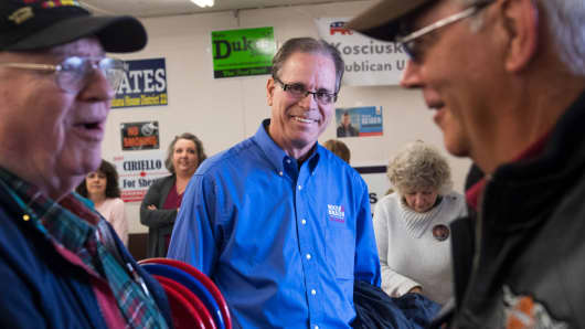 Mike Braun, center, who is running for the Republican nomination for Senate in Indiana, attends the Kosciusko County Republican Fish Fry in Warsaw, Ind., on April 4, 2018.
