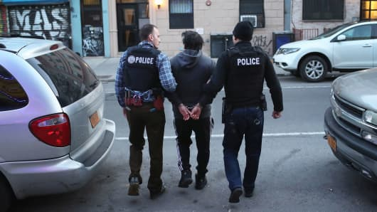 U.S. Immigration and Customs Enforcement (ICE), officers arrest an undocumented Mexican immigrant during a raid in the Bushwick neighborhood of Brooklyn on April 11, 2018 in New York City.