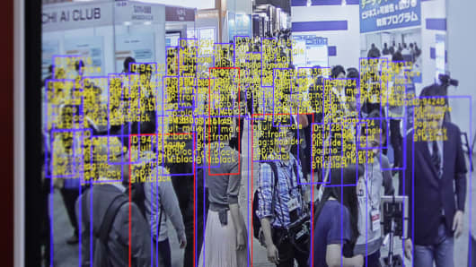 The object detection and tracking technology developed by SenseTime is displayed on a screen at the Artificial Intelligence Exhibition & Conference in Tokyo, Japan, on Wednesday, April 4, 2018. SenseTime raised the most money ever for an AI start-up in April in a deal led by Alibaba.