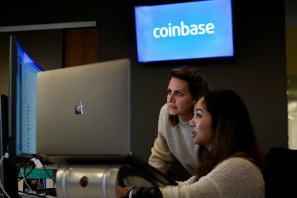 Employees work at the Coinbase Inc. office in San Francisco, California.