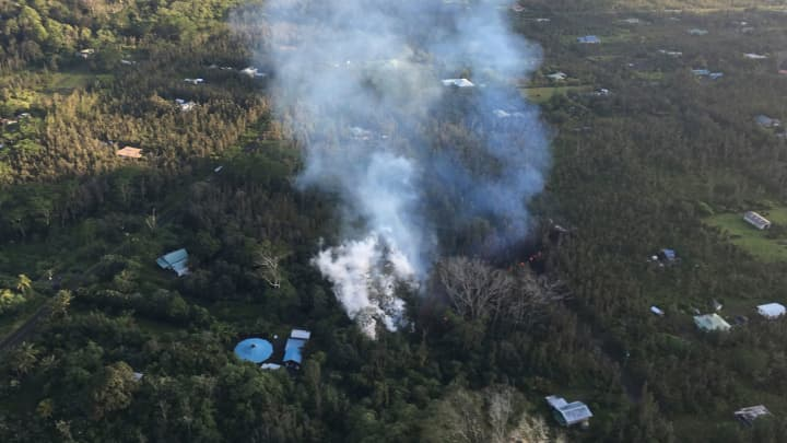 In this photo released by U.S. Geological Survey, lava is shown burning in Leilani Estates subdivision near the town of Pahoa on Hawaii's Big Island Thursday, May 3, 2018 in Hawaii Volcanoes National Park.