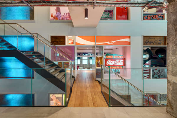 Office space memorabilia Killed The Threestorey Heritage Wall At Cocacolas Gb Hq In London Contains Memorabilia Cohen Carnaggio Reynolds Look Inside Cocacolas London Office Where Secret Drinks Are