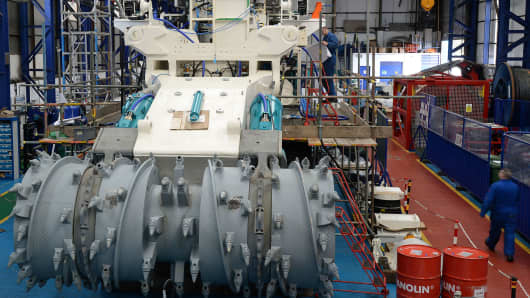 Employees of Soil Machine Dynamics (SMD) work on a subsea mining machine.