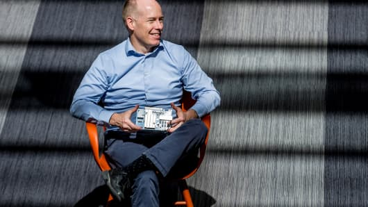 Microsoft distinguished engineer Doug Burger and a Project Brainwave accelerator.