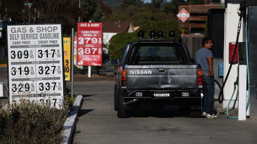 A customer pumps gas into his truck at a Gas & Shop gas station in San Anselmo, California.