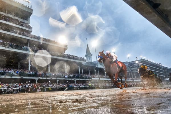 Justify (7), ridden by jockey Mike Smith crosses the finish line to win the 144th running of the Kentucky Derby at Churchill Downs