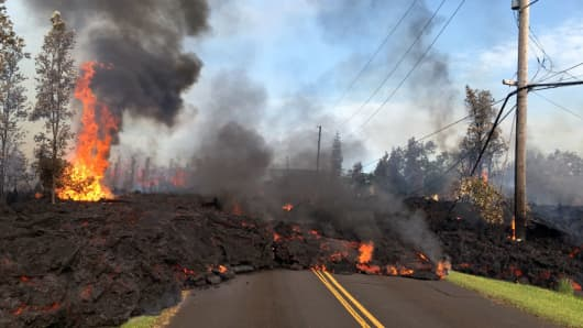 Lava from a fissure slowly advances to the northeast on Hookapu Street after the eruption of Hawaii's Kilauea volcano on May 5, 2018 in the Leilani Estates subdivision near Pahoa, Hawaii.