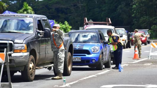 Authorities, including police and the National Guard, check the identification of returning evacuees to their homes at Leilani Estates near the town of Pahoa on May 6, 2018.