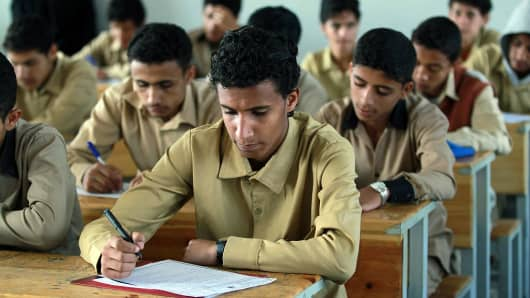 Yemeni male students take final school year exams at a secondary school