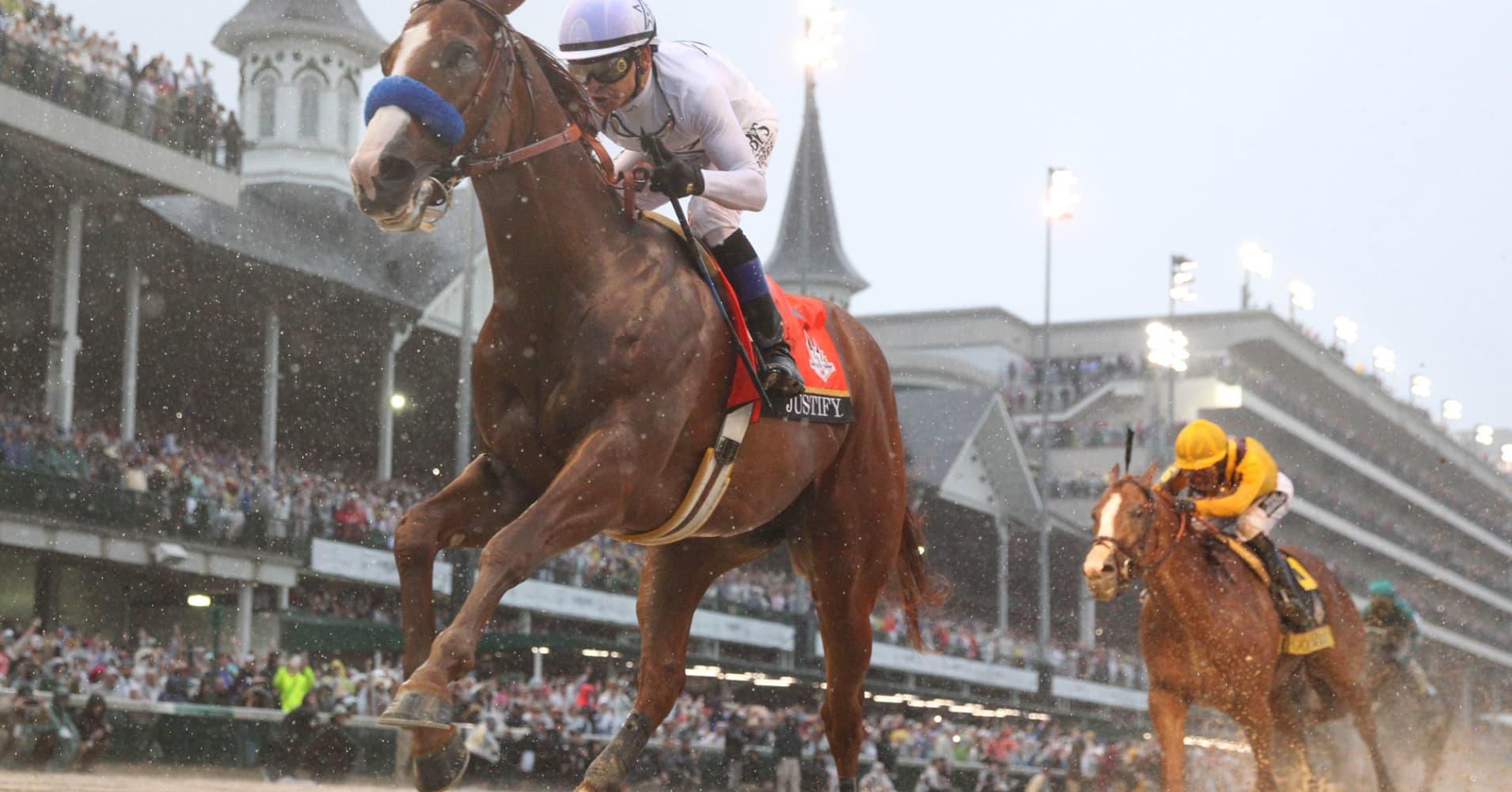 Justify wins Triple Crown at Belmont Stakes
