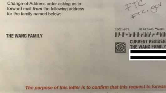 One of the change-of-address orders thieves filled out to redirect the Wang family's mail.