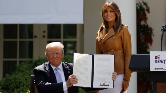 U.S. first lady Melania Trump stands with President Donald Trump after he signed the Be Best initiative in the Rose Garden of the White House in Washington, U.S., May 7, 2018.