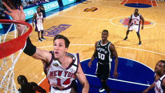 Former New York Knicks player Chris Dudley, seen here at the 1999 NBA Finals in New York, says there are lessons to be learned from pro athletes' financial troubles.