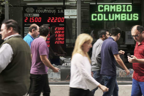 Currency exchange values are seen in the buy-sell board of an exchange bureau in Buenos Aires, Argentina on May 07, 2018.
