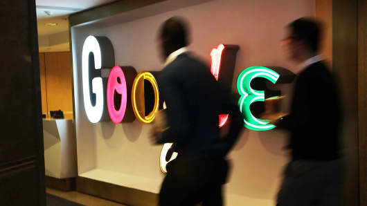 People walk in Google's New York offices