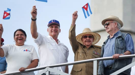 Cuba's First Secretary of the Communist Party and former President Raul Castro (2-R), Cuba's President Miguel Diaz-Canel (2-L), First Secretary of the Communist Party in Havana Lazara Mercedes Lopez (L) and president of the Communist Party of Chile Guillermo Teillier watch the May Day rally in Havana, Cuba, May 1, 2018.