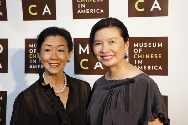 Lulu Wang, chief executive officer of Tupelo Capital Management and Jenny Ming, former chief executive officer of Old Navy, pose for a photo at the 30th Anniversary Gala for the Museum of Chinese in America, in New York, on Wednesday, Dec. 16, 2009.
