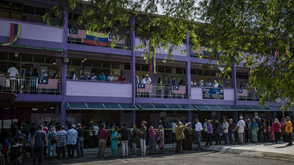 Voters wait in line at a polling station in Kampung Baru for the 14th general election on May 9, 2018 in Kuala Lumpur, Malaysia. Millions of Malaysians headed to the polls on Wednesday in a fiercely contested general election between the ruling coalition of Prime Minister Najib Razak and 92-year-old former leader Mahathir Mohamad.