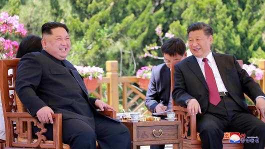 North Korean leader Kim Jong Un meets with China's President Xi Jinping, in Dalian.