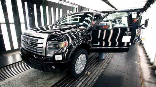 A Ford F-150 truck goes through a quality control inspection after undergoing assembly at the Ford Dearborn Truck Plant.