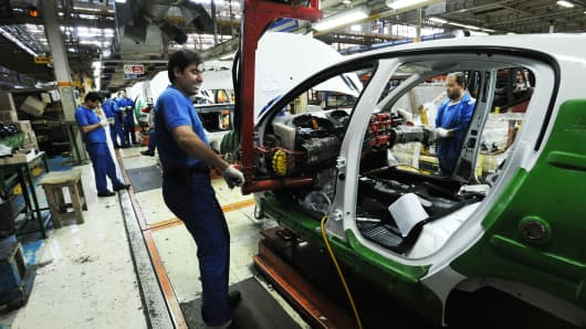 Workers at the Iranian Khodro car manufacturing plant make Iranian car models as well as vehicles under license of the French company Peugeot in Tehran, Iran.