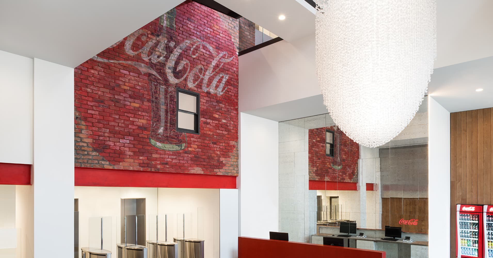 Welcome to Coca-Cola's reception at its London offices. Fun fact, the light sculpture by Stuart Haygarth, features over 80,000 acrylic ice chunks and are suspended on ultra fine wires and illuminated by LEDs.