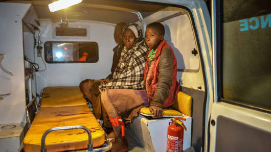 Local residents wait inside an ambulance after Patel dam burst its bank at Solai, about 40 kilometres north of Nakuru, Kenya, on May 9, 2018.