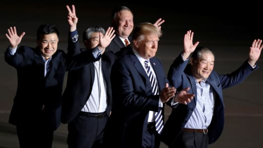 The three Americans formerly held hostage in North Korea gesture next to U.S.President Donald Trump and Secretary of State Mike Pompeo, upon their arrival at Joint Base Andrews, Maryland, May 10, 2018.
