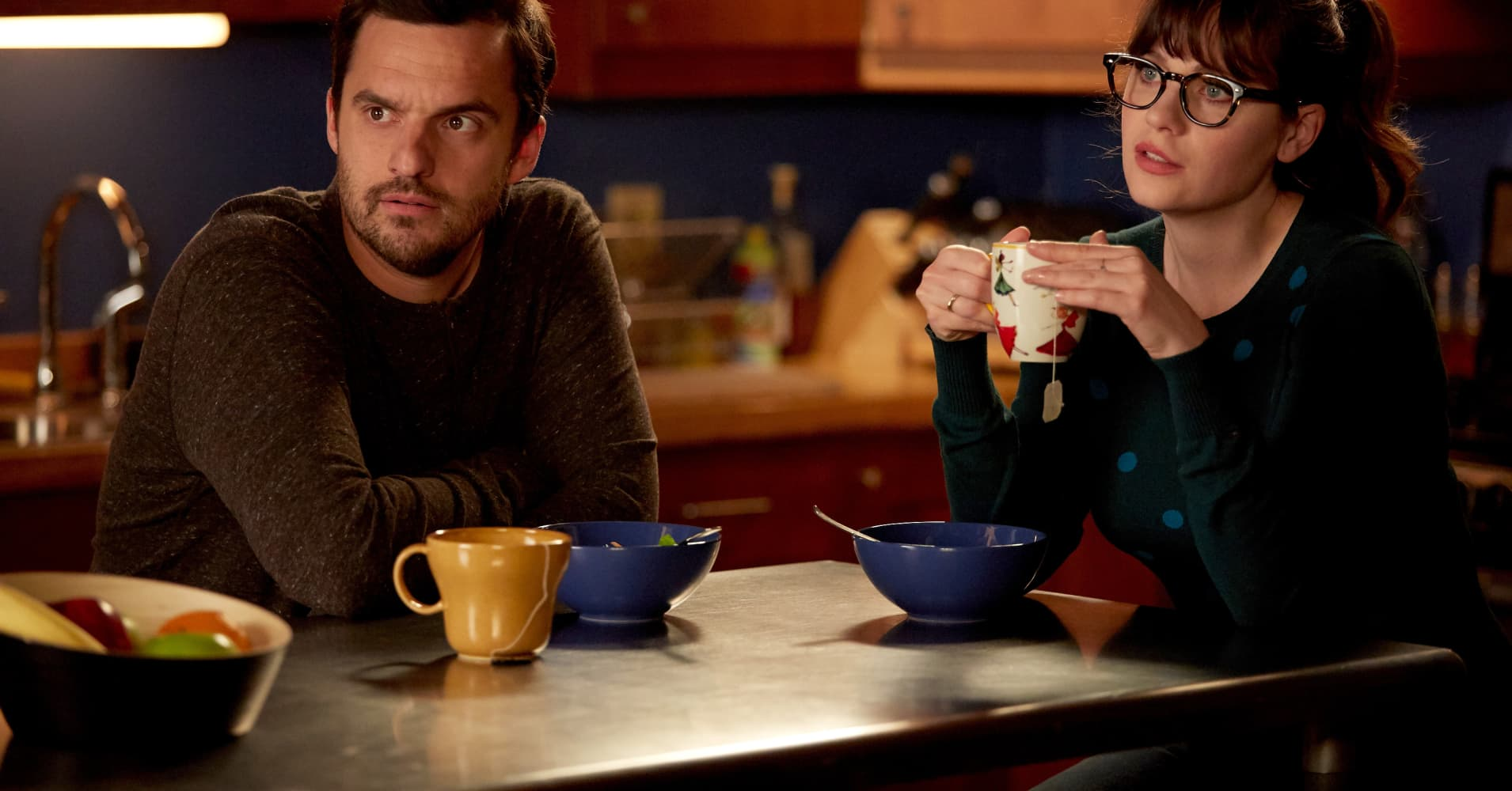 "Jake Johnson and Zooey Deschanel as Nick and Jess in ""New Girl"""
