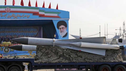 An Iranian military truck carries surface-to-air missiles past a portrait of Iran's Supreme Leader Ayatollah Ali Khamenei during a parade on the occasion of the country's annual army day on April 18, 2018, in Tehran.
