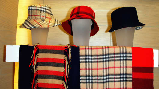 Burberry hats and scarves are shown at an accessory shop.