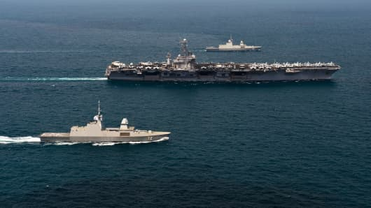 The Nimitz-class aircraft carrier USS John C. Stennis and the Republic of Singapore navy frigates RSS Formidable and RSS Stalwart are seen underway in the Singapore Strait.
