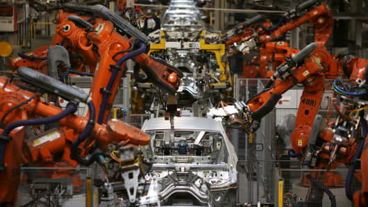Robots weld together Bayerische Motoren Werke AG (BMW) X4 sports utility vehicle (SUV) body frames at the BMW Manufacturing Co. assembly plant in Greer, South Carolina.