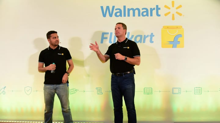 Walmart CEO Doug McMillon (R) speaking next to Flipkart co-founder and CEO Binny Bansal at an event in Bangalore, as a deal was announced for Walmart to buy a stake in Flipkart. - US retail behemoth Walmart will buy a 77 percent stake in Indian e-commerce giant Flipkart for $16 billion, Walmart said in a statement May 9.