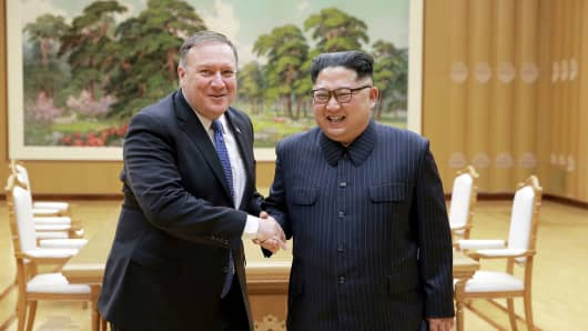 North Korean leader Kim Jong Un shakes hands with U.S. Secretary of State Mike Pompeo in this May 9, 2018 photo released on May 10, 2018 by North Korea