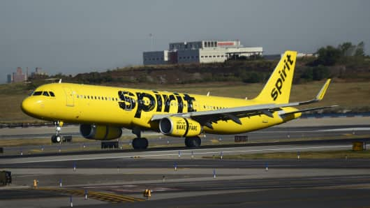 A Spirit Airlines passenger jet lands at LaGuardia Airport in New York, New York.