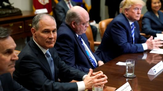 Environmental Protection Agency (EPA) Administrator Scott Pruitt (2nd L) attends as U.S. President Donald Trump meets with chief executives of major U.S. and foreign automakers at the White House in Washington, U.S. May 11, 2018.