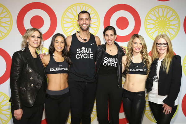 (L-R) SoulCycle Co-Founder Julie Rice, instructors Charlee Akins and Marvin Foster, CEO Melanie Whelan, instructor Emily Turner, and Co-Founder Elizabeth Cutler attend the SoulCycle x Target Launch Event on January 14, 2016 in New York City.