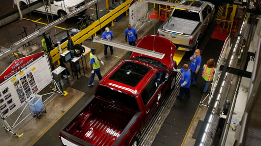 Ford Motor Co. F150 trucks move along the production line at the company's Dearborn Truck Assembly facility in Dearborn, Michigan.