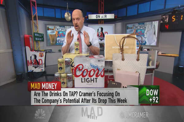 Cramer compares Michael Kors and Molson Coors and picks the better stock