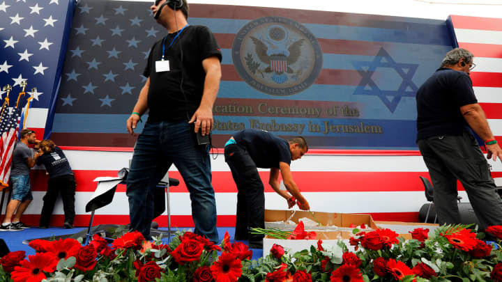 Embassy staff prepare the stage ahead of the controversial inauguration of the US embassy in Jerusalem on May 14, 2018.