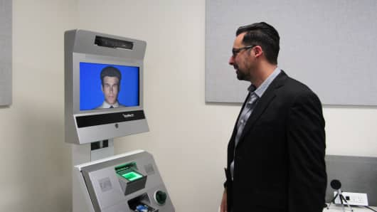 Aaron Elkins, a professor at the San Diego State University, is working on a kiosk system that can ask travelers questions at an airport or border crossings and capture behaviors to detect if someone is lying.