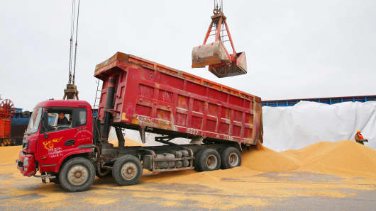 Workers transport imported soybeans at a port in Nantong, China.